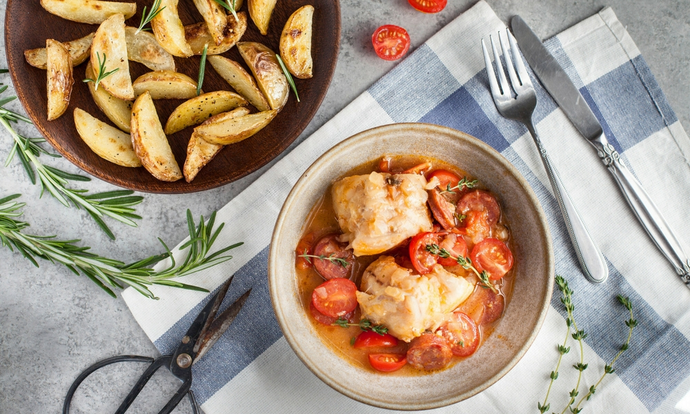 Monkfish with chorizo, tomatoes and onions, with sauteed potatoes,